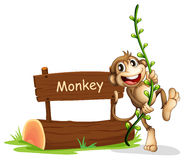 A smiling monkey beside a signage Royalty Free Stock Photos