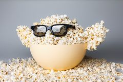 Smiling Monster of popcorn, glasses Royalty Free Stock Images