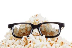 Smiling Monster of popcorn, glasses. Isolated on white Royalty Free Stock Image