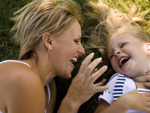 Smiling Mother And Little Daughter On Nature. Happy People Outdoors Royalty Free Stock Photos