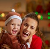 Smiling mother and baby in christmas decorated kitch Stock Photo