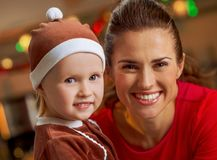 Smiling mother and baby in christmas decorated kitch Royalty Free Stock Images