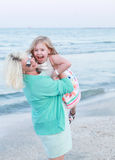 Smiling mother and baby girl having fun time. Royalty Free Stock Photos