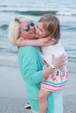 Smiling mother and baby girl having fun time. Stock Photo