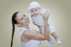 Smiling mother with baby on hands Royalty Free Stock Image