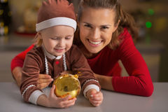 Smiling mother and baby holding christmas ball Stock Photos