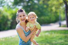 Smiling mother and baby playing in park Royalty Free Stock Image