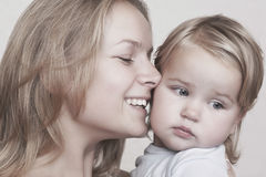 Smiling Mother Caressing Baby Girl Royalty Free Stock Image