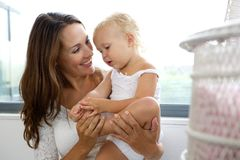 Smiling mother caring for her daughter Royalty Free Stock Images