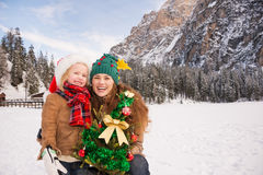 Smiling mother and child with Christmas tree into the mountains Stock Image