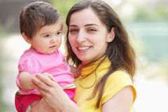 Smiling mother with child closeup Stock Image