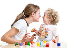Smiling mother and child girl painting together Stock Image