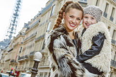 Smiling mother and child nearby Eiffel tower in Paris, France Royalty Free Stock Images