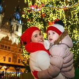 Smiling mother and child tourists at Christmas in Prague Royalty Free Stock Image