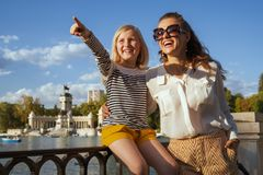 Smiling mother and child travellers pointing at something royalty free stock photos