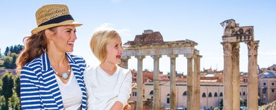 Smiling mother and child travellers in Rome having excursion Royalty Free Stock Image