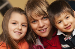 Smiling mother and children. Smiling mother and her children royalty free stock photography