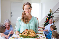 Smiling mother with Christmas meal Royalty Free Stock Images