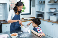 Smiling mother cooking with her son Stock Photo