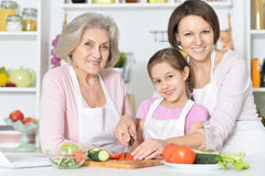 Mother, daughter and grandmother cooking together Stock Images
