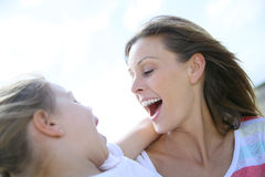 Smiling mother and daughter having fun Royalty Free Stock Photography