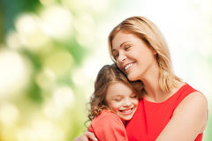 Smiling mother and daughter hugging Stock Images