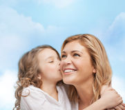 Smiling mother and daughter hugging Stock Image