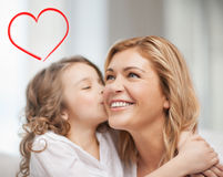Smiling mother and daughter hugging Royalty Free Stock Photo