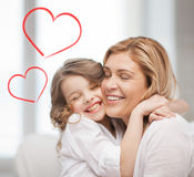 Smiling mother and daughter hugging Royalty Free Stock Photography