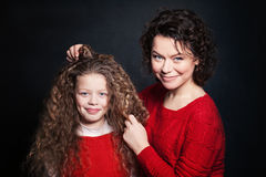 Smiling Mother and Daughter with Long Curly Hair Stock Image