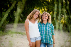 Smiling mother daughter looking at camera, outdoor shot. Stock Photography