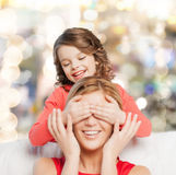 Smiling mother and daughter making a joke Royalty Free Stock Photo
