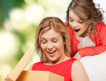 Smiling mother and daughter opening gift box stock photography