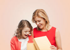 Smiling mother and daughter with opening gisft box Stock Photo