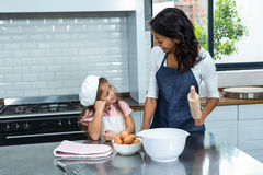 Smiling mother and daughter ready to cook in the kitchen Royalty Free Stock Photo