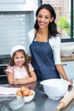 Smiling mother and daughter ready to cook Stock Image