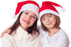 Smiling mother and daughter in Santa hats Royalty Free Stock Image