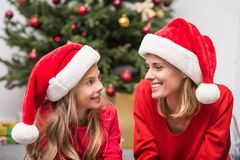 Mother and daughter in Santa hats on christmas Royalty Free Stock Photo