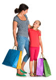 Smiling mother and daughter with shopping bags Royalty Free Stock Photos