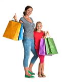 Smiling mother and daughter with shopping bags Stock Images