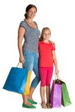 Smiling mother and daughter with shopping bags Royalty Free Stock Photo