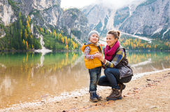 Smiling mother and daughter on the shore of Lake Bries Stock Image