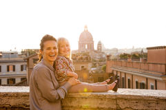 Smiling mother and daughter at sunset in Rome, St. Peters Stock Photography