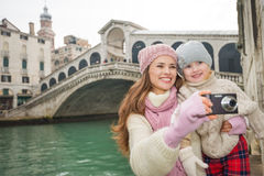 Smiling mother and daughter taking photos near Ponte di Rialto Royalty Free Stock Photo