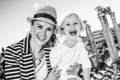 Smiling mother and daughter tourists in front of Roman Forum Stock Photography
