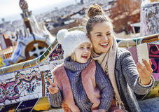 Smiling mother and daughter tourists taking selfie in Barcelona Royalty Free Stock Images