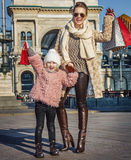 Smiling mother and daughter travellers in Milan rejoicing Royalty Free Stock Photo
