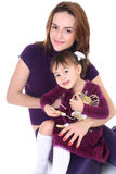 Smiling mother and daughter in violet royalty free stock photo