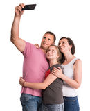 Smiling mother, father and daughterl making selfie stock photos