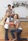 Smiling mother giving daughter the school lunch royalty free stock photo